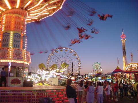 People enjoying thrill rides at the Minnesota State Fair