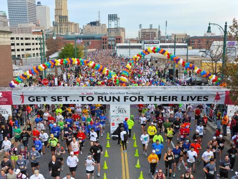 Participants cross the finish line at the St. Jude Marathon