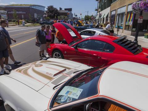 Admiring classic cars participating in the Woodward Dream Cruise
